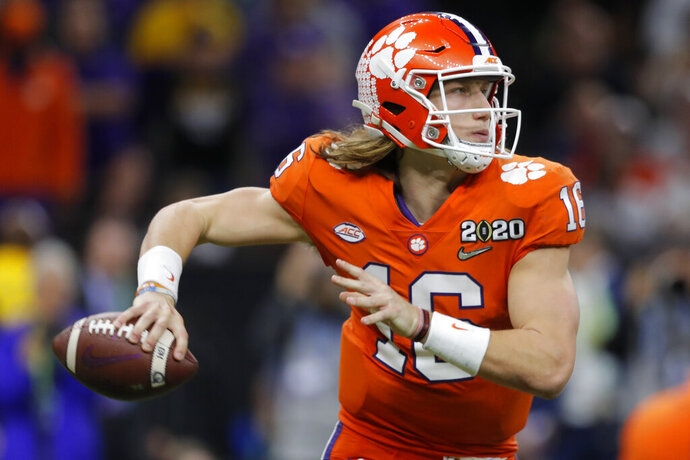 FILE - In this Jan. 13, 2020, file photo, Clemson quarterback Trevor Lawrence looks to pass against LSU during the second half of an NCAA College Football Playoff national championship game in New Orleans. The top-ranked Tigers are 29-1 over the past two seasons and have won five straight ACC championships. (AP Photo/Gerald Herbert, File)