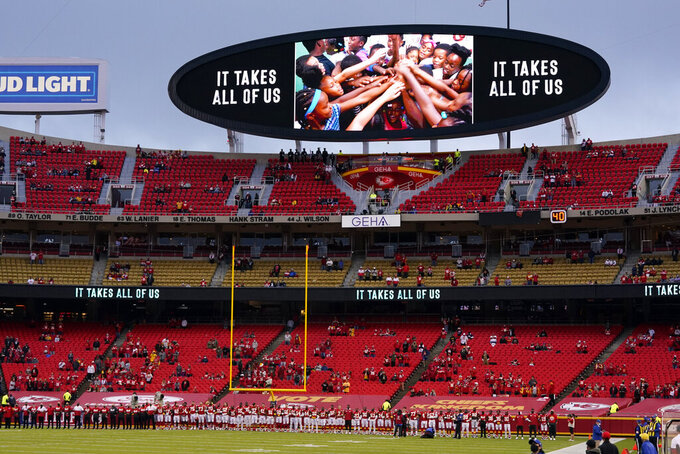 Kansas City Chiefs players and fans stand for a presentation on social justice before an NFL football game against the Houston Texans Thursday, Sept. 10, 2020, in Kansas City, Mo. (AP Photo/Jeff Roberson)