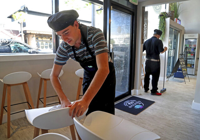 Levi Gold attends a job training session at the Friendship Cafe on Las Olas Boulevard as he prepares for the cafe's debut on Wednesday, Jan. 15, 2020, in Fort Lauderdale, Fla. Gold feels protected at Friendship Café, a new fast-casual Mediterranean restaurant and coffee shop on a mission to hire and train adults with special needs. (Susan Stocker/South Florida Sun-Sentinel via AP)