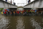 People make their way through a flooded underpass in Chennai, India, Wednesday, Nov.25, 2020. India's southern state of Tamil Nadu is bracing for Cyclone Nivar that is expected to make landfall on Wednesday. The state authorities have issued an alert and asked people living in low-lying and flood-prone areas to move to safer places. (AP Photo/R. Parthibhan)