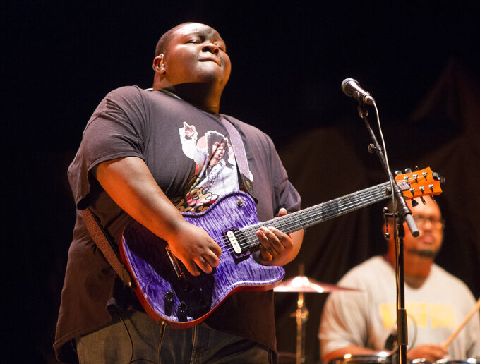 """FILE - Christone """"Kingfish"""" Ingram performs at TD Pavilion at the Mann on Sept. 4, 2019, in Philadelphia. Ingram and Shemekia Copeland  were among the top winners at the Blues Music Awards held in Memphis, Tennessee on Sunday. Ingram, who won five times last year, took home the contemporary blues male artist and guitar instrumentalist awards. (Photo by Owen Sweeney/Invision/AP, File)"""