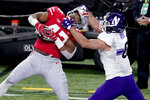 Ohio State linebacker Justin Hilliard, left, intercepts a pass intended for Northwestern tight end John Raine a during the second half of the Big Ten championship NCAA college football game, Saturday, Dec. 19, 2020, in Indianapolis. (AP Photo/Darron Cummings)