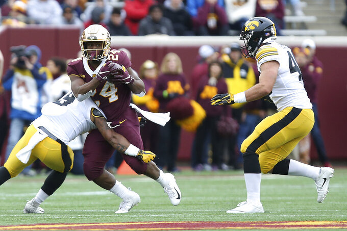 Minnesota running back Mohamed Ibrahim is stopped by Iowa defensive back Geno Stone during an NCAA college football game Saturday, Oct. 6, 2018, in Minneapolis. (AP Photo/Stacy Bengs)