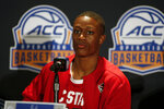 North Carolina State basketball player CJ Bryce answers a question during the Atlantic Coast Conference NCAA college basketball media day in Charlotte, N.C., Tuesday, Oct. 8, 2019. (AP Photo/Nell Redmond)