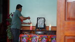 FILE - In this Saturday, Oct. 26, 2019 file photo, a family member of Bui Thi Nhung lights incense sticks from a candle at an altar with Nhung's portrait inside her home home in Do Thanh village, Nghe An province, Vietnam. Ten teenagers were among the 39 Vietnamese found dead in a truck container in southeast England last month, local police said Friday, Nov. 8 while relaying for the first time details of those who died. Two of the dead were only 15, while the oldest was 44. Some 20 of the victims came from one province — Nghe An in north central Vietnam, around 200 kilometers (120 miles) south of Hanoi. Bui Thi Nhung was among the dead.  (AP Photo/Linh Do, file)