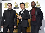 Jason Cole, from left, Hiro Murai and Ibra Ake pose in the press room with the award for best music video for Childish Gambino's