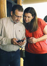 FILE - In this Aug. 27, 2019, file photo, Republican Megan Dahle, right, checks early election results with husband, state Sen. Brian Dahle, at her election watch party in Redding, Calif. Dahle, of Bieber, is in a special election, Tuesday, Nov. 5, 2019, against Democrat Elizabeth Betancourt for the First Assembly District seat vacated when Dahle's husband was elected to the California Senate. (Mike Chapman/The Record Searchlight via AP, File)