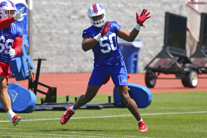 Buffalo Bills defensive end Greg Rousseau (50) runs a drill during an NFL football rookie minicamp in Orchard Park, N.Y., Friday, May 14, 2021. (AP Photo/Jeffrey T. Barnes)