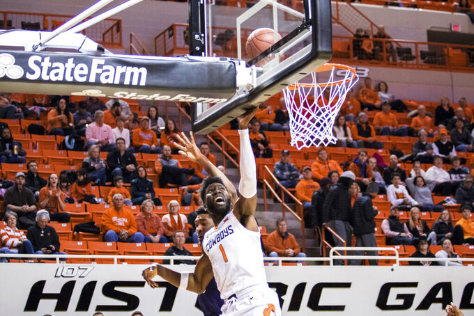 Oklahoma State's Jonathan Laurent shoots during the team's NCAA college basketball game against TCU on Wednesday, Feb. 5, 2020, in Stillwater, Okla. (Devin Lawrence/Tulsa World via AP)