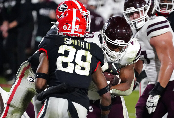 Mississippi State running back Dillon Johnson (23) scores a touchdown against Georgia during the first half of an NCAA college football game, Saturday, Nov. 21, 2020, in Athens, Ga. (AP Photo/Brynn Anderson)