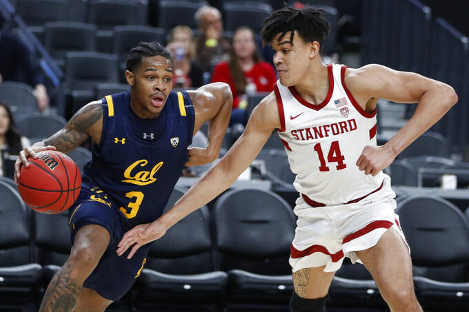 California's Paris Austin (3) drives around Stanford's Spencer Jones (14) during the first half of an NCAA college basketball game in the first round of the Pac-12 men's tournament Wednesday, March 11, 2020, in Las Vegas. (AP Photo/John Locher)