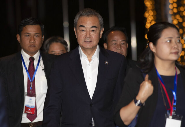 China's Foreign Minister Wang Yi arrives for welcome dinner in Vientiane, Laos, Wednesday, Feb. 19, 2020. The foreign ministers of the Association of Southeast Asian Nations are meeting in Laos Thursday to discuss ways to curb the spread of the new virus infections. (AP Photo/Sakchai Lalit)
