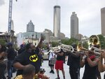 Zachary Nealy leads a brass band calling itself the Protesters Mass Band atop a parking garage in downtown Atlanta, Saturday, June 6, 2020. Nealy says the band's goal is to give protesters