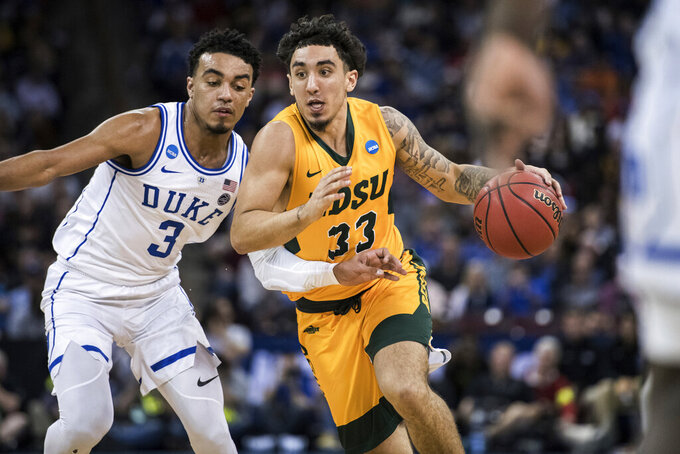 North Dakota State guard Jordan Horn (33) dribbles the ball against Duke guard Tre Jones (3) during the second half of a first-round game in the NCAA men's college basketball tournament Friday, March 22, 2019, in Columbia, S.C. Duke defeated North Dakota State 85-62. (AP Photo/Sean Rayford)