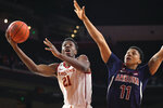 FILE - In this Thursday, Feb. 27, 2020, file photo, Southern California forward Onyeka Okongwu, left, shoots as Arizona forward Ira Lee defends during the first half of an NCAA college basketball game in Los Angeles. Okongwu was selected by the Atlanta Hawks in the NBA draft Wednesday, Nov. 18, 2020. (AP Photo/Mark J. Terrill, File)