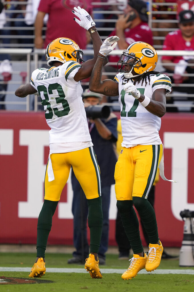Green Bay Packers wide receiver Davante Adams (17) is congratulated by wide receiver Marquez Valdes-Scantling (83) after scoring against the San Francisco 49ers during the first half of an NFL football game in Santa Clara, Calif., Sunday, Sept. 26, 2021. (AP Photo/Tony Avelar)