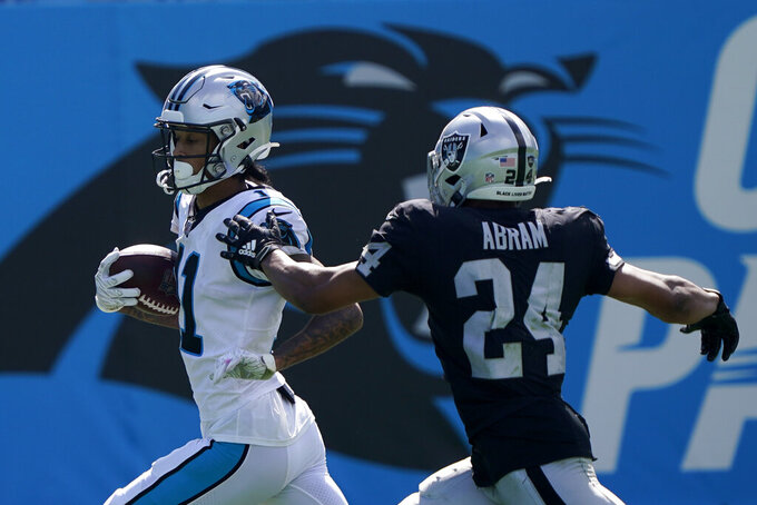 Carolina Panthers wide receiver Robby Anderson, left, scores past Las Vegas Raiders safety Johnathan Abram during the second half of an NFL football game Sunday, Sept. 13, 2020, in Charlotte, N.C. (AP Photo/Brian Blanco)