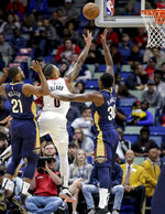 Portland Trail Blazers guard Damian Lillard (0) shoots over New Orleans Pelicans center Julius Randle (30) and forward Darius Miller (21) in the first half of an NBA basketball game in New Orleans, Friday, March 15, 2019. (AP Photo/Scott Threlkeld)