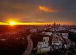 The sun rises over Frankfurt, Germany, with the buildings of the banking district at right, early Thursday, July 2, 2020. (AP Photo/Michael Probst)