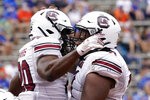 South Carolina running back Kevin Harris, left, celebrates his 9-yard touchdown on a pass play against Florida with teammate offensive lineman Eric Douglas during the second half of an NCAA college football game, Saturday, Oct. 3, 2020, in Gainesville, Fla. (AP Photo/John Raoux, Pool)