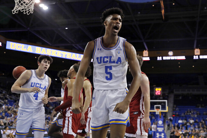 UCLA guard Chris Smith (5) celebrates after scoring against Washington State during the first half of an NCAA college basketball game Thursday, Feb. 13, 2020, in Los Angeles. (AP Photo/Marcio Jose Sanchez)