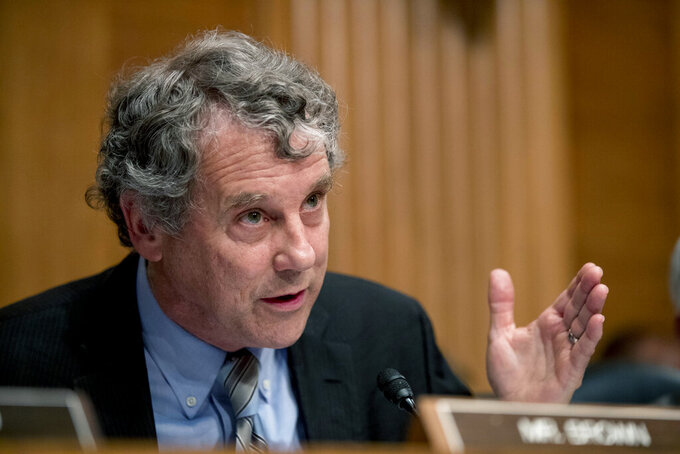 """FILE - In this Sept. 10, 2019 file photo, Sen. Sherrod Brown, D-Ohio, speaks before a Senate Banking Committee hearing in Washington. Republican Ohio Gov. Mike DeWine has gotten criticism from within his own party for his aggressive anti-coronavirus measures, but the state's Democratic senator had praise for him Friday, Mary 7, 2021. """"I think the governor has had a steady hand in this,"""" Brown said while visiting the Cincinnati Health Department to promote getting vaccinated against COVID-19.(AP Photo/Andrew Harnik, File)"""