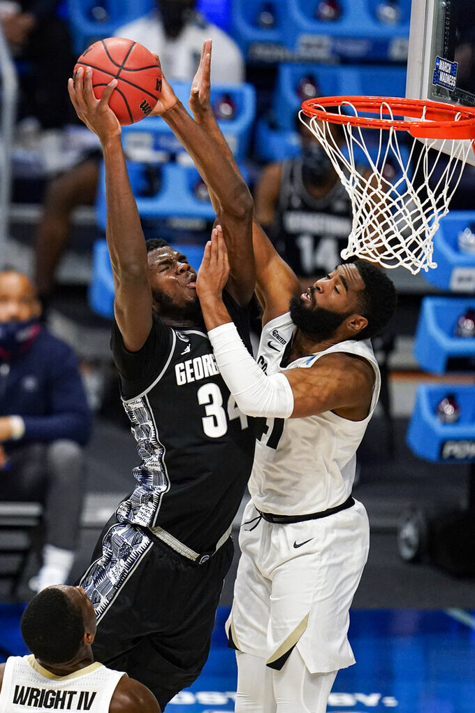 Colorado forward Jeriah Horne (41) fouls Georgetown center Qudus Wahab (34) in the second half of a first-round game in the NCAA men's college basketball tournament at Hinkle Fieldhouse in Indianapolis, Saturday, March 20, 2021. (AP Photo/Michael Conroy)
