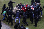 People clash with policemen during an opposition rally to protest the official presidential election results in Minsk, Belarus, Sunday, Oct. 11, 2020. Belarus' authoritarian president Alexander Lukashenko on Saturday visited a prison to talk to opposition activists, who have been jailed for challenging his re-election that was widely seen as manipulated and triggered two months of protests. (AP Photo)