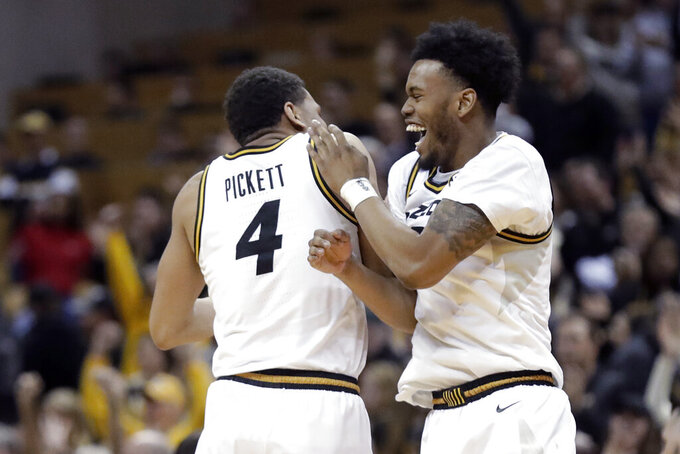 Missouri's Javon Pickett (4) and Torrence Watson celebrate the team's 72-69 victory over Georgia in an NCAA college basketball game Tuesday, Jan. 28, 2020, in Columbia, Mo. (AP Photo/Jeff Roberson)