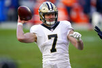 New Orleans Saints quarterback Taysom Hill (7) throws against the Denver Broncos during the first half of an NFL football game, Sunday, Nov. 29, 2020, in Denver. (AP Photo/David Zalubowski)