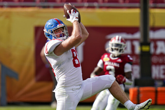 Mississippi tight end Casey Kelly pulls in a touchdown pass against Indiana during the first half of the Outback Bowl NCAA college football game Saturday, Jan. 2, 2021, in Tampa, Fla. (AP Photo/Chris O'Meara)