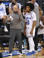 Head coach Mick Cronin speaks with Tyger Campbell #10 of the UCLA Bruins against the Oregon State Beavers in the first half of a NCAA basketball game at Pauley Pavilion in Westwood on Saturday, January 30, 2021. (Keith Birmingham/The Orange County Register via AP)