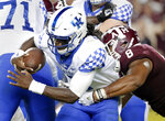 Kentucky quarterback Terry Wilson (3) is sacked by Texas A&M defensive lineman Kingsley Keke (8) during the second half of an NCAA college football game Saturday, Oct. 6, 2018, in College Station, Texas. (AP Photo/Michael Wyke)
