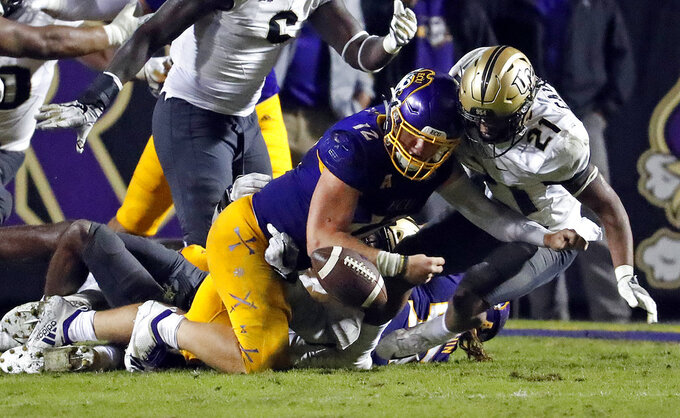 East Carolina's Holton Ahlers (12) is stopped from recovering his fumble by Central Florida's Rashard Causey (21) during the second half of an NCAA college football game in Greenville, N.C., Saturday, Oct. 20, 2018. UCF won 37-10. (AP Photo/Karl B DeBlaker)