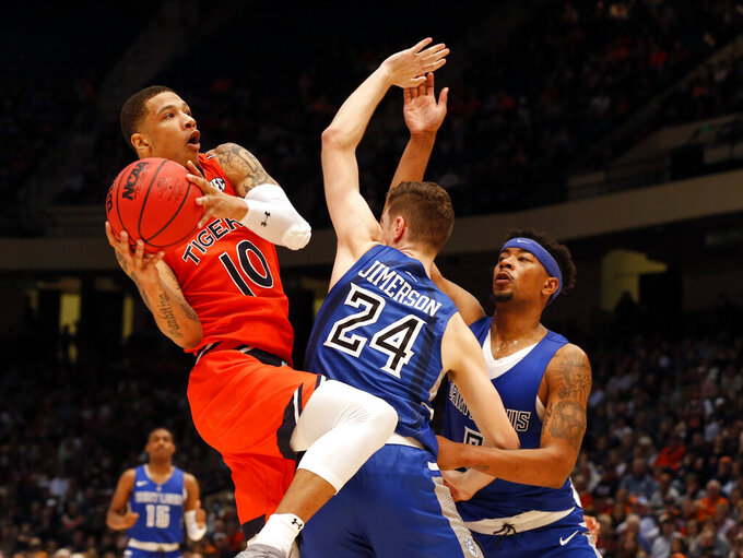 Auburn guard Samir Doughty (10) shoots over Saint Louis guard Gibson Jimerson (24) and guard Jordan Goodwin (0) during the first half of an NCAA college basketball game Saturday, Dec. 14, 2019, in Birmingham, Ala. (AP Photo/Butch Dill)