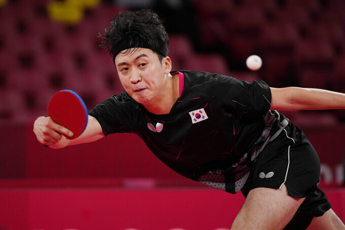 South Korea's Jeoung Youngsik competes during the table tennis men's singles third round match against Greece's Panagiotis Gionis at the 2020 Summer Olympics, Tuesday, July 27, 2021, in Tokyo. (AP Photo/Kin Cheung)