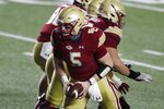 Boston College quarterback Phil Jurkovec (5) looks to the backfield during the second half of the team's NCAA college football game against Louisville, Saturday, Nov. 28, 2020, in Boston. (AP Photo/Michael Dwyer)