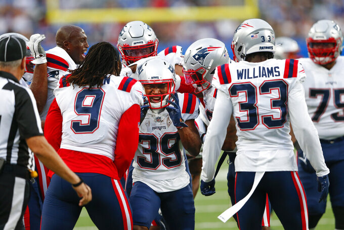 New England Patriots cornerback D'Angelo Ross (39) celebrates with teammates after intercepting a pass in the end zone during the first half of an NFL preseason football game against the New York Giants Sunday, Aug. 29, 2021, in East Rutherford, N.J. (AP Photo/Noah K. Murray)