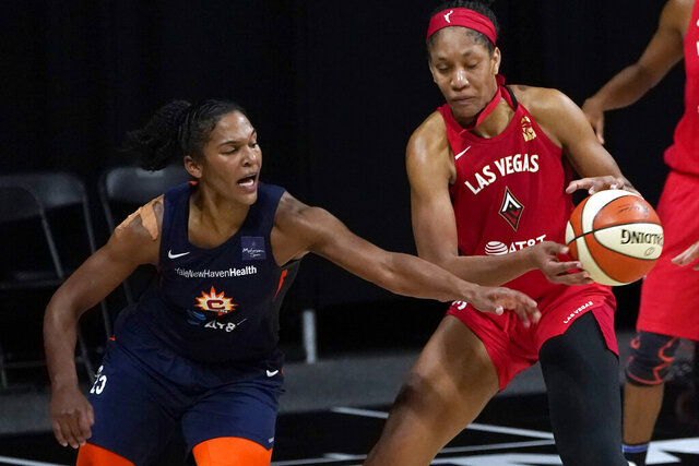 Connecticut Sun forward Alyssa Thomas (25) knocks the ball away from Las Vegas Aces center A'ja Wilson (22) during the second half of Game 3 of a WNBA basketball semifinal round playoff series Thursday, Sept. 24, 2020, in Bradenton, Fla. (AP Photo/Chris O'Meara)
