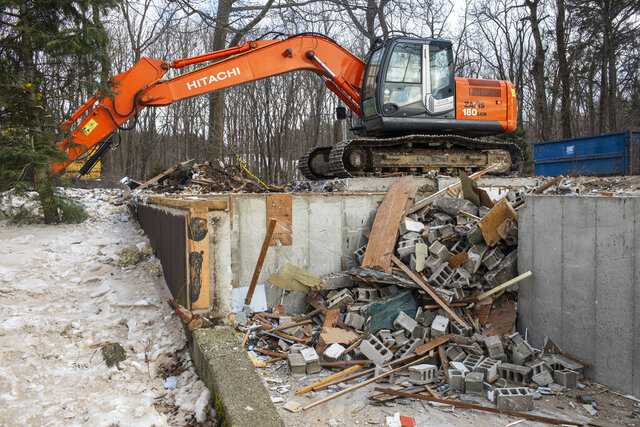 A view of the remains of the home that is being demolished in the 2200 block of Lakeshore Drive in Ganges, Michigan on Tuesday, Jan. 21, 2020. The property owners decided to demolish the house with the collapsing dune growing closer to the edge of the home. The home has been in the Curtis family since the 1930s. (Joel Bissell/Kalamazoo Gazette via AP)