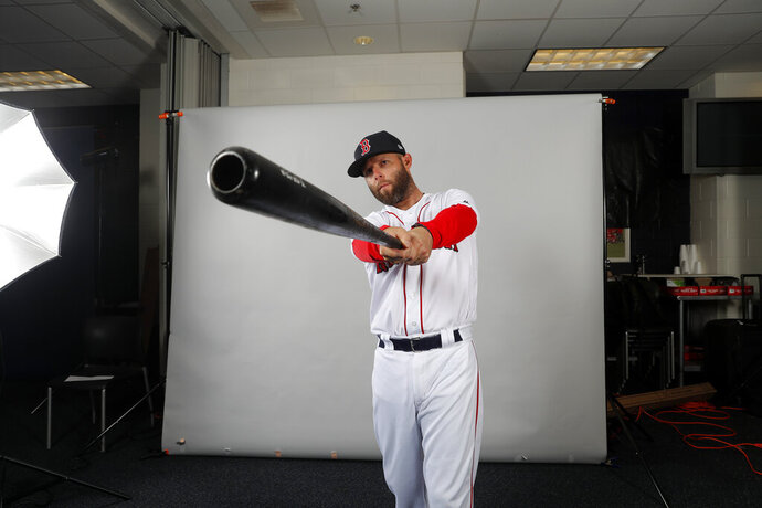 Boston Red Sox second baseman Dustin Pedroia sets up for a portrait during media day at their spring training baseball facility in Ft. Myers, Fla., Tuesday, Feb. 19, 2019. (AP Photo/Gerald Herbert)
