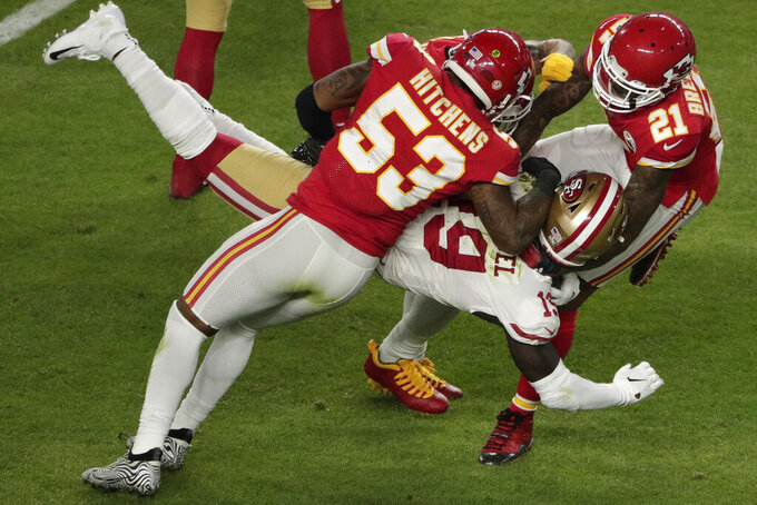 San Francisco 49ers' Deebo Samuel (19) is stopped by Kansas City Chiefs' Anthony Hitchens (53) and Bashaud Breeland (21), during the first half of the NFL Super Bowl 54 football game, Sunday, Feb. 2, 2020, in Miami Gardens, Fla. (AP Photo/Charlie Riedel)