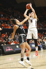 Oregon State's Mikayla Pivec (0) shoots over the head of Hawaii's Jadynn Alexander (15) during the first half of an NCAA college basketball game in Corvallis, Ore., Friday, Dec. 6, 2019. (AP Photo/Amanda Loman)