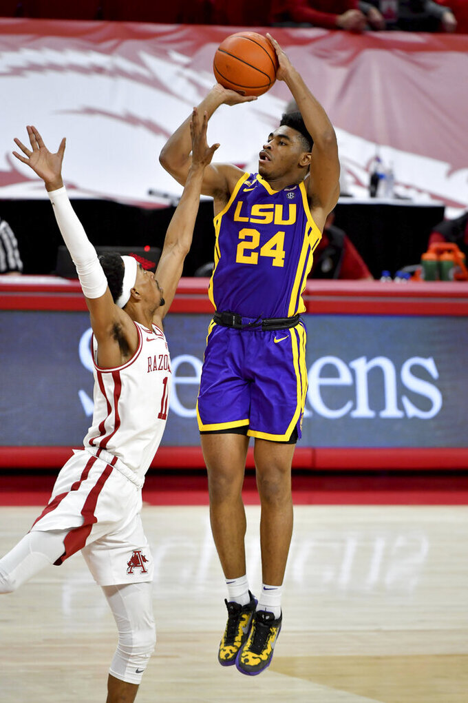 LSU guard Cameron Thomas (24) shoots over Arkansas guard Jalen Tate (11) during the second half of an NCAA college basketball game in Fayetteville, Ark. Saturday, Feb. 27, 2021. (AP Photo/Michael Woods)