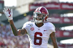 Alabama's DeVonta Smith reacts after scoring a touchdown during the first half of an NCAA college football game against South Carolina Saturday, Sept. 14, 2019, in Columbia, S.C. DeVonta Smith is The Associated Press college football player of the year, becoming the first wide receiver to win the award since it was established in 1998, Tuesday, Dec. 29, 2020. (AP Photo/Richard Shiro)
