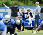 Detroit Lions owner and chairman Martha Firestone Ford, third from left, watches the Lions NFL football training camp with, from left, General Manager Bob Quinn, granddaughter Eliza Getz and team President Rod Wood Wednesday, June 5, 2019, in Allen Park, Mich. (AP Photo/Duane Burleson)