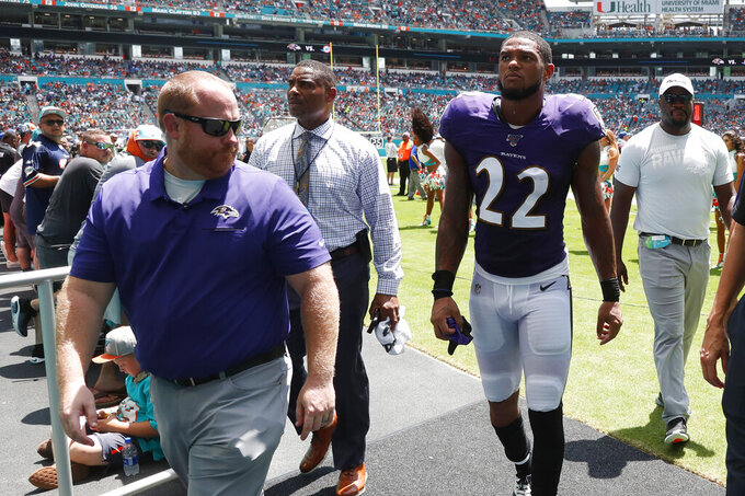 FILE - In this Sunday, Sept. 8, 2019, file photo, Baltimore Ravens cornerback Jimmy Smith (22) walks off the field after an injury during the first half at an NFL football game against the Miami Dolphins, in Miami Gardens, Fla. Jimmy Smith will miss several weeks after spraining his knee in Sunday's game against Miami. Coach John Harbaugh said Monday, Sept. 9, 2019, that Smith has a Grade 2 sprain of the right knee. (AP Photo/Wilfredo Lee, File)