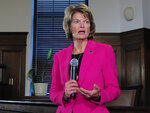FILE - In this Feb. 18, 2020, photo, U.S. Sen. Lisa Murkowski speaks with reporters in Juneau, Alaska. The leaders of Alaska's Republican Party on Saturday, July 10, 2021 endorsed a challenger to incumbent U.S. Sen. Lisa Murkowski, who has been one of the GOP's most outspoken critics of former President Donald Trump, the Anchorage Daily News reported. The Alaska Republican State Central Committee endorsed Kelly Tshibaka in the 2022 race for the U.S. Senate seat held by Murkowski. (AP Photo/Becky Bohrer, File)