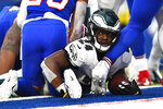 Philadelphia Eagles' Jordan Howard looks up after scoring a touchdown during the second half of an NFL football game against the Buffalo Bills, Sunday, Oct. 27, 2019, in Orchard Park, N.Y. (AP Photo/Adrian Kraus)