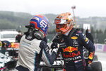 First place for pole position Red Bull driver Max Verstappen of the Netherlands, right, congratulates second place, Williams driver George Russell of Britain after the qualification ahead of the Formula One Grand Prix at the Spa-Francorchamps racetrack in Spa, Belgium, Saturday, Aug. 28, 2021. The Belgian Formula One Grand Prix will take place on Sunday. (John Thys, Pool Photo via AP)